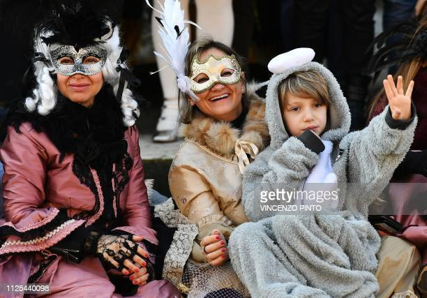 Masked revellers on the Grand Canal watch the opening regatta of the Venice Carnival on February 17 2019 The carnival in Venice takes place until...