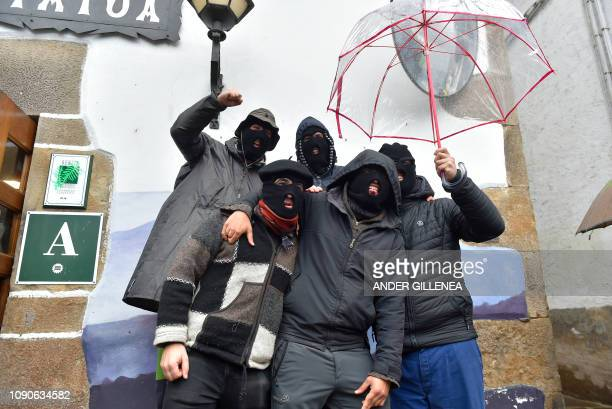 Masked revellers pose as they participate in the ancient carnival of Ituren in the northern Spanish Navarra province on January 28 2019 The yearly...
