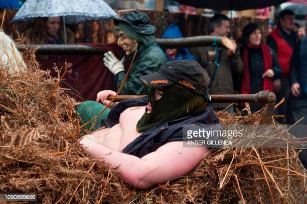 Masked revellers take part in celebrations of the ancient carnival of Zubieta in the northern Spanish Navarra province on January 29 2019 The yearly...