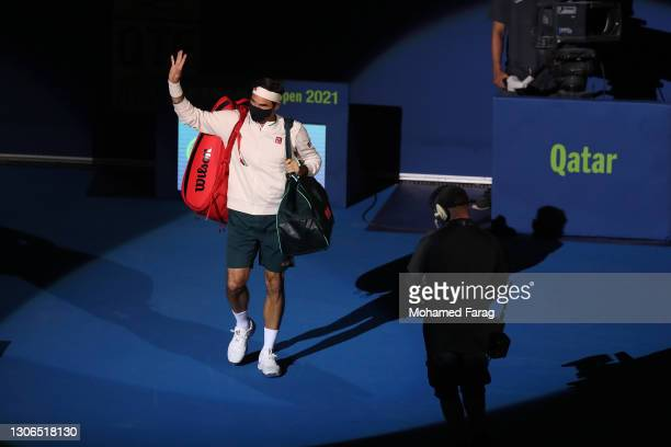 Masked Roger Federer of Switzerland walks onto the court for his quarter final match with Nikoloz Basilashvili of Georgia in the Qatar ExxonMobil...