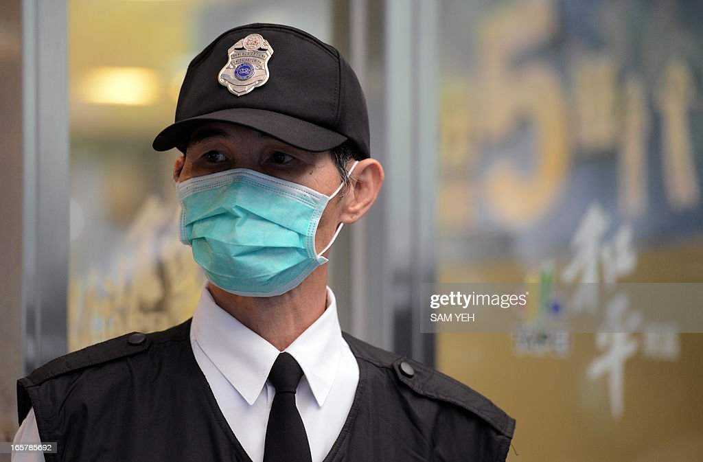 A masked security guard stand outside Taipei Hoping Hospital on April 6, 2013 where new isolation units have been set up to treat potential new H7N9 avian influenza cases. Taiwan enhanced its level of alert against bird flu and set up a contingency centre on April 3 after reports in mainland China of new infections from a new strain of avian influenza. The new infections alarmed the authorities in Taiwan, which is separated from the Chinese mainland only by a 180-kilometre (111.6 miles) strait and which has seen a dramatic influx of 2.6 million Chinese visitors last year due to the fast warming ties between Taipei and Beijing. AFP PHOTO / Sam Yeh