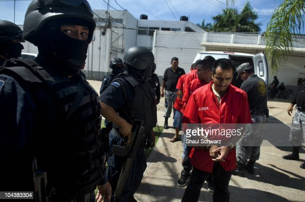 Masked security police transfer new inmates to prison where thousands of inmates are detained in Culiacan Sinaloa July 06 2003 The Culiacan prison is...