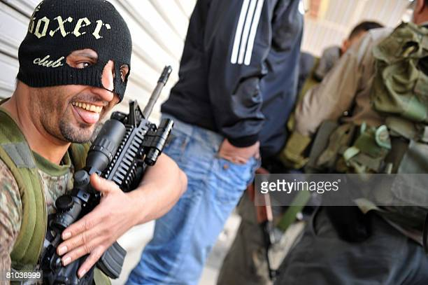 Masked Shiite gunman smiles as Hezbollah fighters seized control of west Beirut on May 9, 2008. The Hezbollah-led opposition seized control of the...