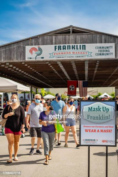 masked shoppers at the franklin farmers market - brycia james stock pictures, royalty-free photos & images