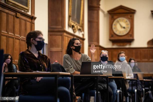 Masked students sit in a socially distanced class in the Examination Schools of the University of Oxford on November 24, 2020 in Oxford, England. The...