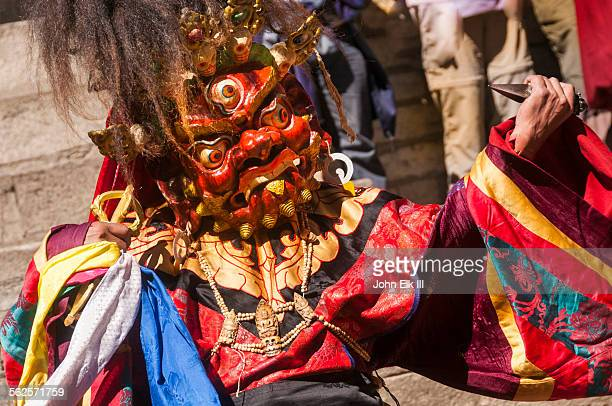 masked temple dancer - tibetan culture stock pictures, royalty-free photos & images