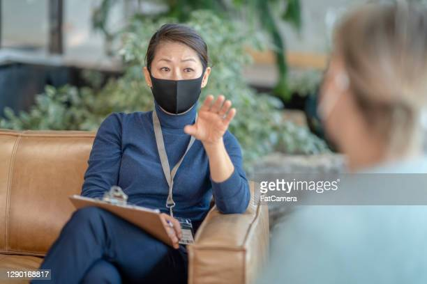 masked therapy session - fatcamera stock pictures, royalty-free photos & images
