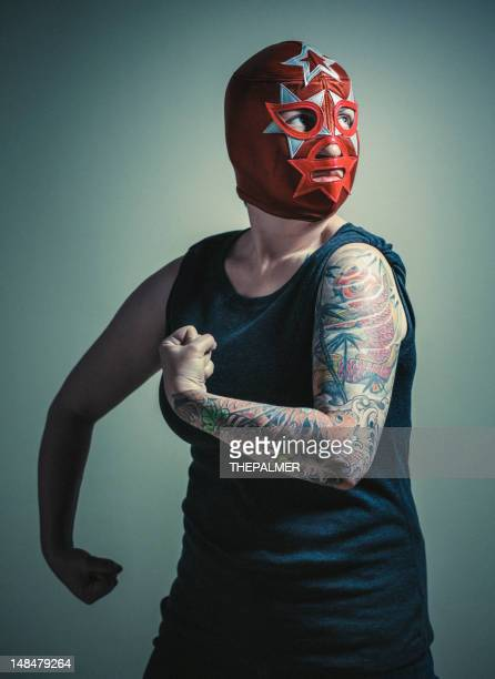 masked woman with tattoos - female wrestling stock photos and pictures