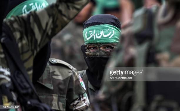 Masked youth cadets from the Ezzedine alQassam Brigades the armed wing of the Palestinian Islamist Hamas movement march in the southern Gaza Strip...