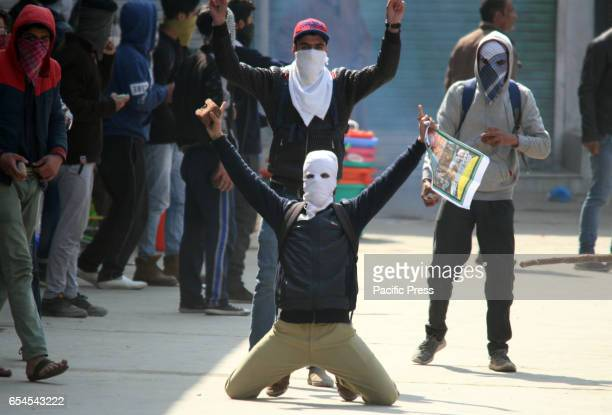 Masked youth clash with government forces after mandatory Friday congregational prayers ended on Friday in Srinagar Controlled Kashmir