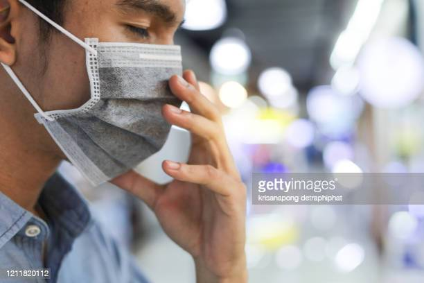 mask,man wearing protection mask against novel coronavirus (2019-ncov) ,.healthcare concept - obscured face stock pictures, royalty-free photos & images