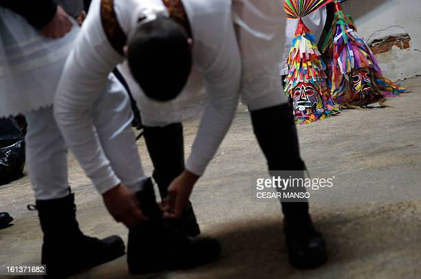 Masks are seen as two Antruejos get ready during the carnival of Velilla de la Reina in the northern Spanish province of Leon on February 10 2013 AFP...