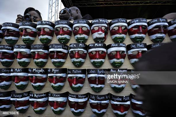 Masks containing the names of the victims of the attack on Garissa University College are displayed during a memorial concert in downtown Nairobi on...