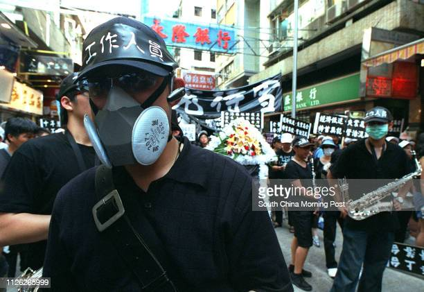 Masks featured in the march - as a protest at the government's handling of the Sars crisis. More than half a million Hong Kong people take to the...
