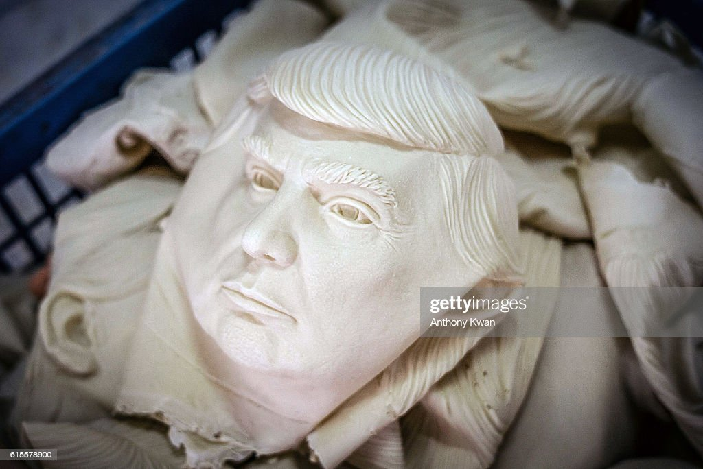 Masks of Donal Trump are seen in a basket at the Shenzhen Lanbingcai Latex Crafts Factory on October 18, 2016 in Shenzhen, China. Shenzhen Lanbingcai Latex Crafts Factory, located in the industrial area of Shenzhen with 20 to 30 employees, produces all sort of Halloween party costumes and masks. It runs a small scale production of Donald Trump masks for local distribution within mainland China costing from 30 renminbi onwards as the third Presidential Debate 2016 between Donald Trump and Hillary Clinton is scheduled on October 19. Chinese media have derided the election as a risible variety show in which the candidates' spectacular personal failings have taken precedence over the business of governance.