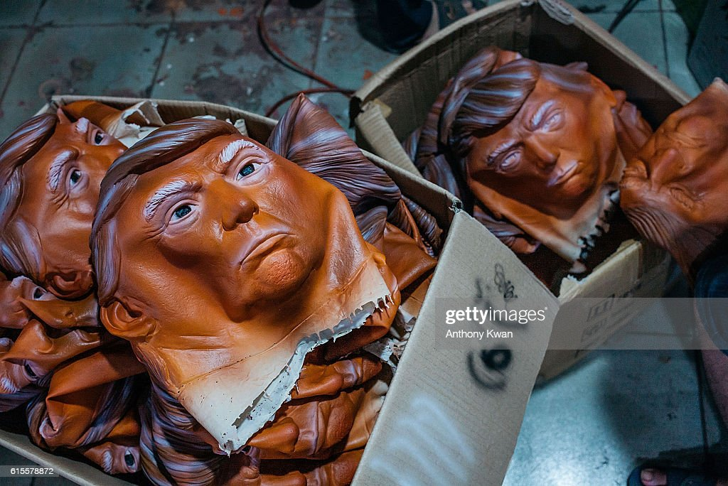 Masks of Donald Trump are seen in boxes at the Shenzhen Lanbingcai Latex Crafts Factory on October 18, 2016 in Shenzhen, China. Shenzhen Lanbingcai Latex Crafts Factory, located in the industrial area of Shenzhen with 20 to 30 employees, produces all sort of Halloween and party costumes and masks. It runs a small scale production of Donald Trump masks for local distribution within mainland China costing from 30 Renminbi onwards as the third Presidential Debate 2016 between Donald Trump and Hillary Clinton happens on Thursday. Chinese media have derided the election as a risible variety show in which the candidates' spectacular personal failings have taken precedence over the business of governance.