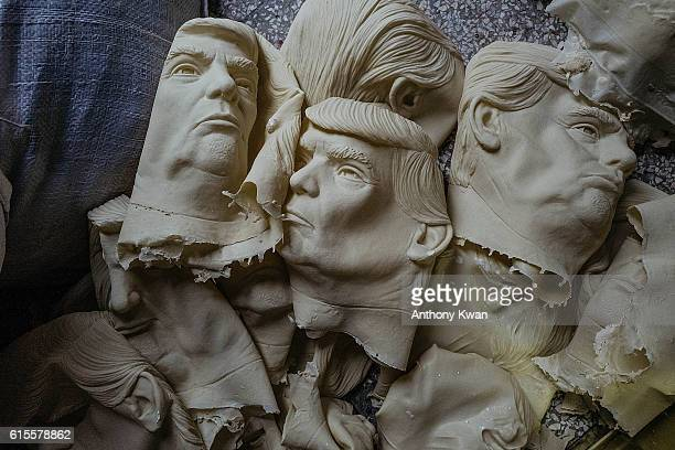 Masks of Donald Trump are seen on the floor at the Shenzhen Lanbingcai Latex Crafts Factory on October 18 2016 in Shenzhen China Shenzhen Lanbingcai...