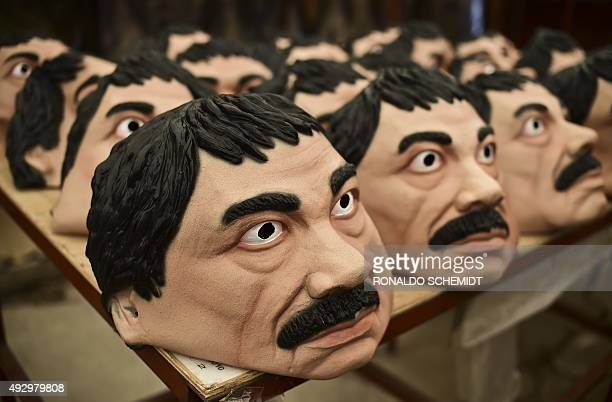 """Masks of the Mexican drug trafficker Joaquin Guzman Loera aka """"El Chapo"""" are pictured in a factory of costumes and masks, on October 16 in Jiutepec,..."""