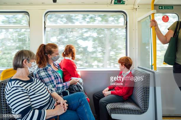 masks on public transport - train interior stock pictures, royalty-free photos & images