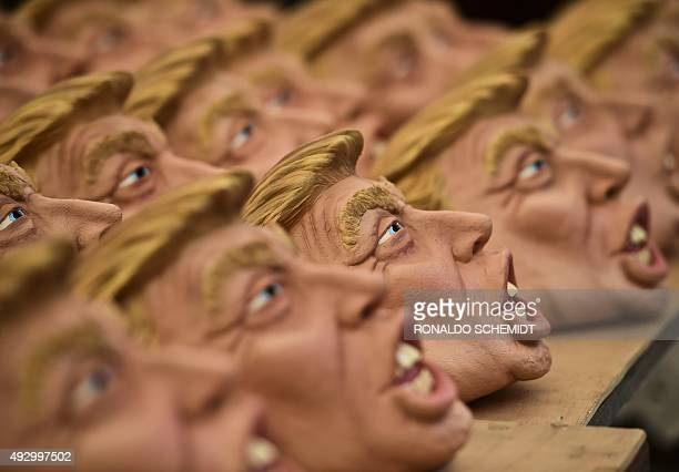 Masks representing US Republican presidential candidate Donald Trump are pictured in a factory of costumes and masks on October 16 in Jiutepec...