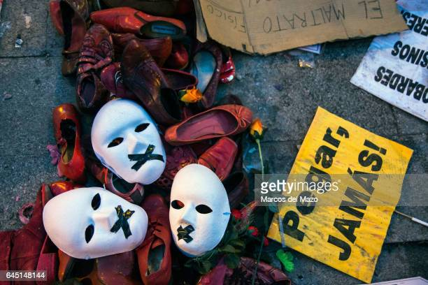 Masks shoes and placards on the floor during a protest against gender violence