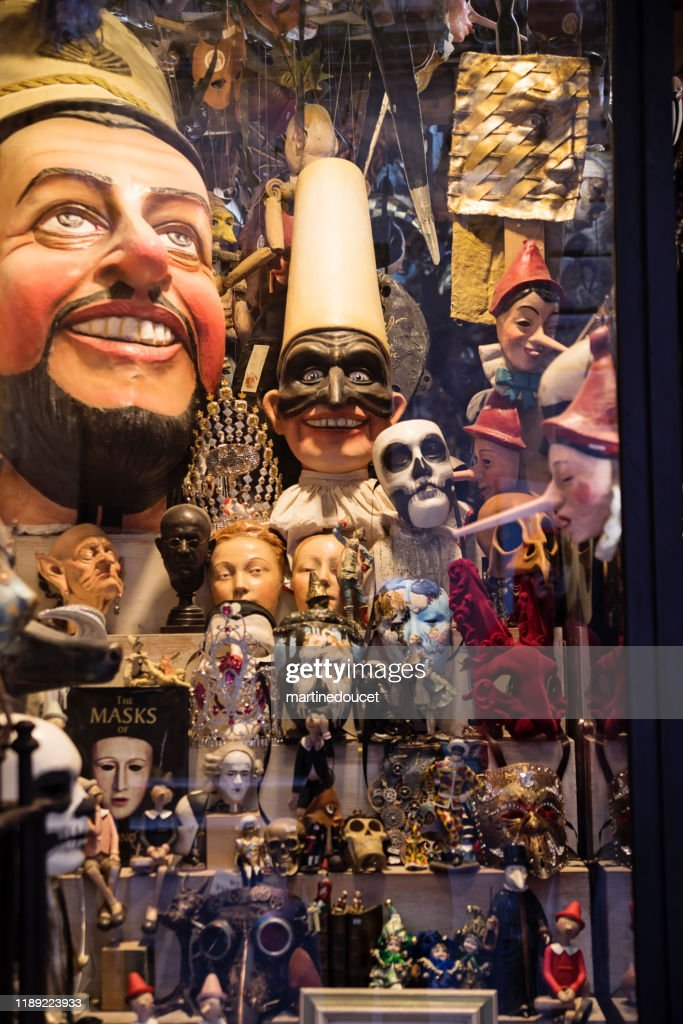 Masks to sell in a small store, Florence Italy : Stock Photo