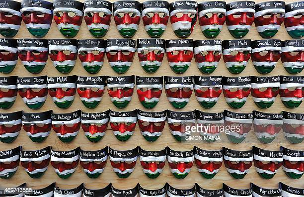 Masks with the names of the victims of the attack on Garissa University College are displayed during a memorial concert in downtown Nairobi on April...