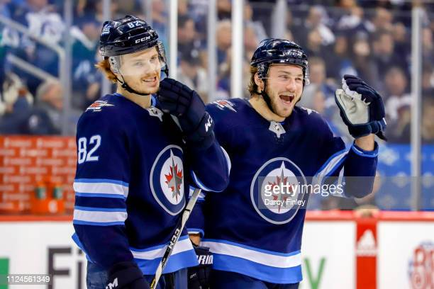 Mason Appleton and Brendan Lemieux of the Winnipeg Jets share a laugh during a second period stoppage in play against the New York Rangers at the...
