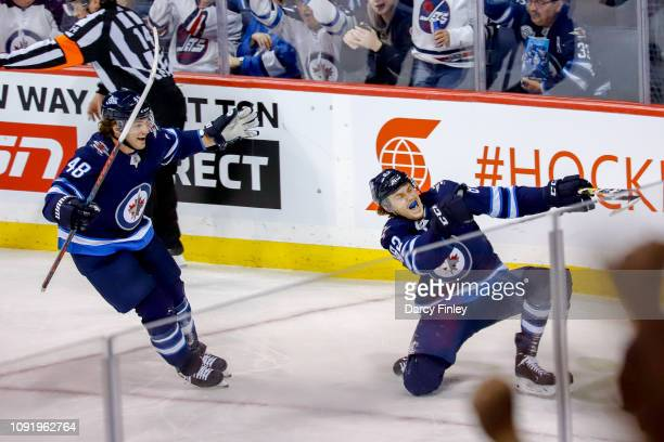 Mason Appleton of the Winnipeg Jets celebrates his second period goal against the Columbus Blue Jackets with teammate Brendan Lemieux at the Bell MTS...