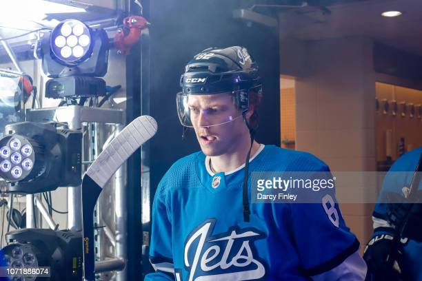 Mason Appleton of the Winnipeg Jets heads to the ice prior to puck drop against the Chicago Blackhawks at the Bell MTS Place on December 11 2018 in...