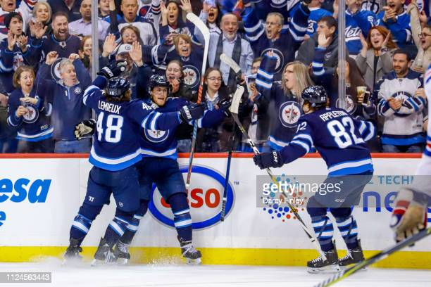 Mason Appleton of the Winnipeg Jets joins teammate Brendan Lemieux and Andrew Copp as they celebrate a third period goal against the New York Rangers...