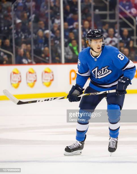 Mason Appleton of the Winnipeg Jets keeps an eye on the play during second period action against the St Louis Blues at the Bell MTS Place on December...
