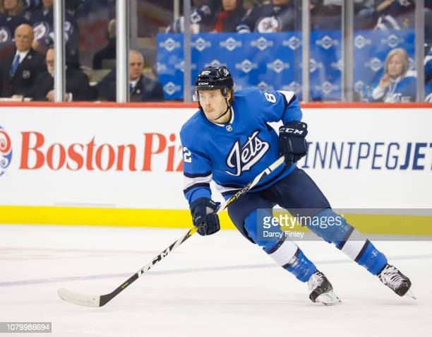 Mason Appleton of the Winnipeg Jets keeps an eye on the play during third period action against the St Louis Blues at the Bell MTS Place on December...