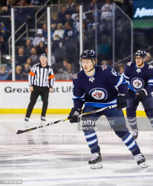 Mason Appleton of the Winnipeg Jets keeps an eye on the play during third period action against the Dallas Stars at the Bell MTS Place on January 6...