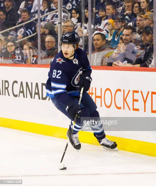 Mason Appleton of the Winnipeg Jets plays the puck behind the net during first period action against the San Jose Sharks at the Bell MTS Place on...