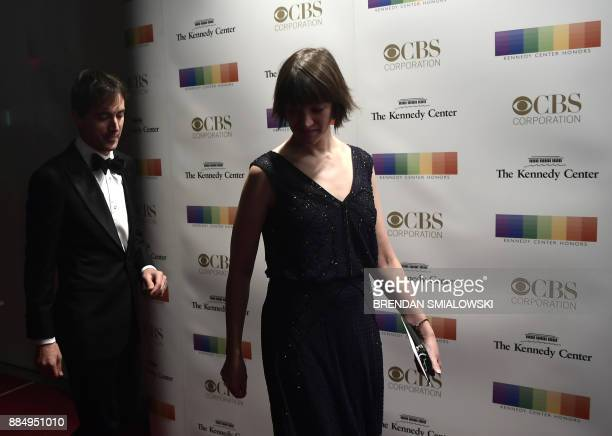 Mason Bates and his sister arrive for the 40th Annual Kennedy Center Honors in Washington DC on December 3 2017 / AFP PHOTO / Brendan Smialowski