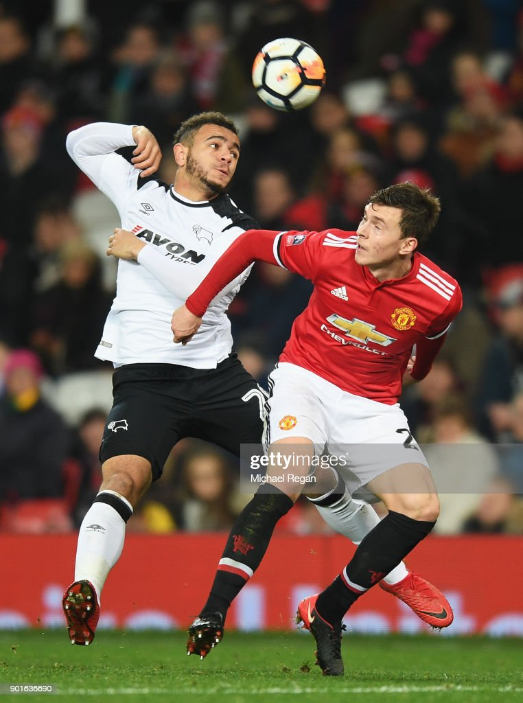 Mason Bennett of Derby County and Victor Lindelof of Manchester United battle for the ball during the Emirates FA Cup Third Round match between Manchester United and Derby County at Old Trafford on January 5, 2018 in Manchester, England.