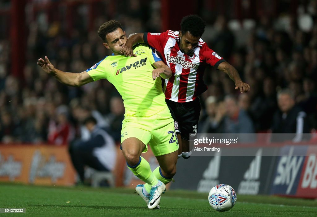 Mason Bennett of Derby County tackles Rico Henry of Brentford during the Sky Bet Championship match between Brentford and Derby County at Griffin Park on September 26, 2017 in Brentford, England.