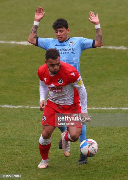 Mason Bennett of Millwall in action Gustavo Hamer of Coventry City with during the Sky Bet Championship match between Coventry City and Millwall at...