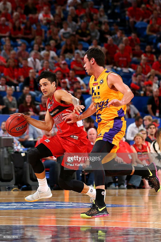 Mason Bragg of the Wildcats controls the ball against Jason Cadee of the Kings during the round seven NBL match between the Perth Wildcats and the Sydney Kings at Perth Arena on November 17, 2016 in Perth, Australia.