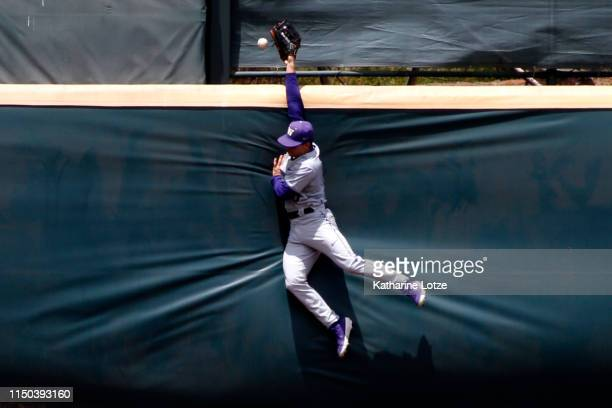 Mason Cerrillo of University of Washington jumps to try to catch the ball during a baseball game UCLA at Jackie Robinson Stadium on May 19, 2019 in...