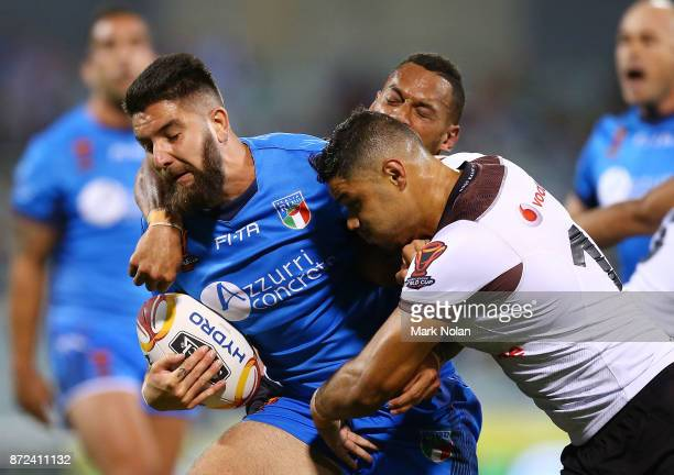 Mason Cerruto of Italy is tackled during the 2017 Rugby League World Cup match between Fiji and Italy at Canberra Stadium on November 10 2017 in...