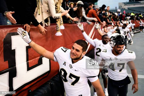 Mason Cholewa of the UCF Knights greets fans after the game at Lincoln Financial Field on November 18 2017 in Philadelphia Pennsylvania UCF defeated...