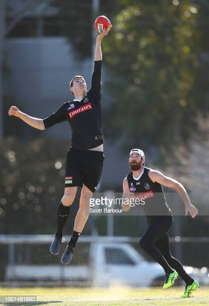 Mason Cox of the Magpies competes for the ball as Tyson Goldsack of the Magpies looks on during a Collingwood Magpies AFL training session at the...