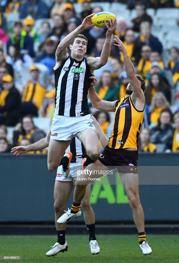 Mason Cox of the Magpies marks over the top of Grant Birchall of the Hawks during the round 15 AFL match between the Hawthorn Hawks and the Collingwood Magpies at Melbourne Cricket Ground on July 2, 2017 in Melbourne, Australia.