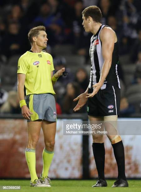 Mason Cox of the Magpies speaks with Umpire Robert Findlay during the 2018 AFL round 10 match between the Collingwood Magpies and the Western...