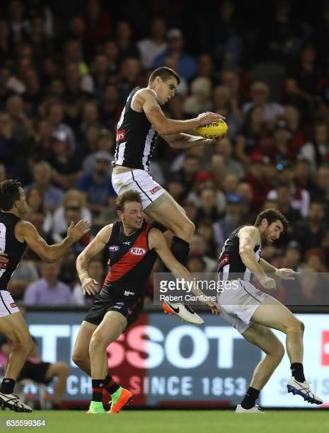 Mason Cox of the Magpies takes a mark during the 2017 JLT Community Series match between the Collingwood Magpies and Essendon Bombers at Etihad...