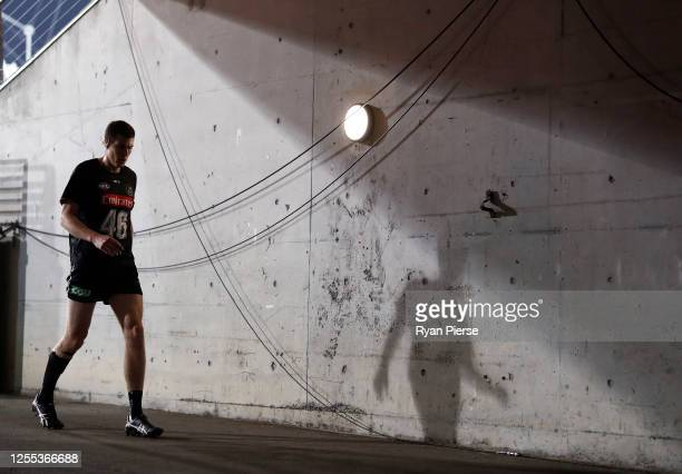 Mason Cox of the Magpies warms up before the round 6 AFL match between the Collingwood Magpies and the Hawthorn Hawks at GIANTS Stadium on July 10...
