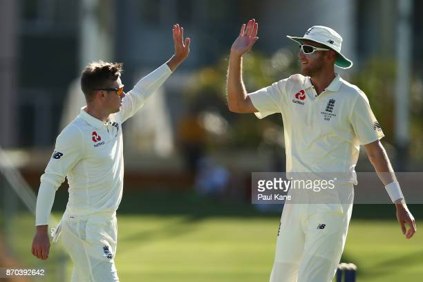 Mason Crane and Stuart Broad of England celebrate the wicket of Aaron Hardie of the WA XI during day two of the Ashes series Tour Match between...