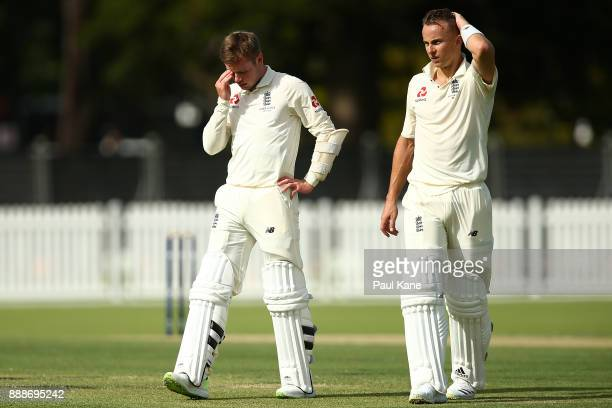 Mason Crane and Tom Curran of England look on at a drinks break during the Two Day tour match between the Cricket Australia CA XI and England at...